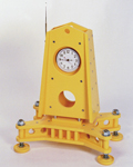 Large yellow clock with moon landing feet