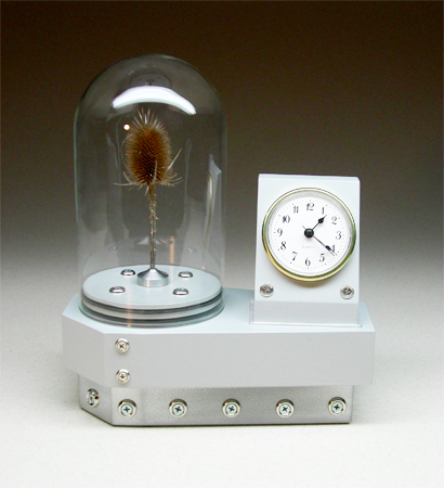 grey clock with dome containing a thistle
